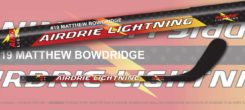 Composite mini hockey sticks personalized with team and player information.