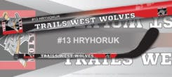 Mini hockey sticks personalized with team and player information.